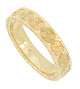 This sparkling 14K yellow gold wedding band is embellished with a ribbon of deeply engraved full figured flowers