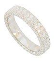 This sparkling 14K white gold wedding band is embellished with deeply engraved abstract organic designs