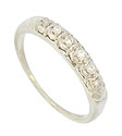 This captivating 14K white gold diamond wedding band sparkles with a row of six fiery round cut diamonds