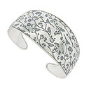 This phenomenal sterling silver cuff bracelet is decorated with a whimsical pattern of flowering branches and songbirds
