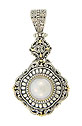 A luminous cultured pearl is set into the center of this handsome antique style sterling silver pendant
