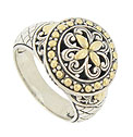 This sparkling antique style sterling silver ring features a round medallion adorned with bold engraved scrollwork and 18K yellow gold leaves
