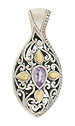 This antique style sterling silver pendant is teardrop shaped, adorned with intricate organic scrollwork and set with a pear cut amethyst