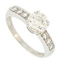 This breathtaking platinum vintage engagement ring features a 1.02 carat, H color, Si2 clarity round cut diamond