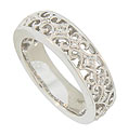 This romantic 14K white gold wedding band features an elegant floral filigree set with fine faceted diamonds