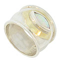 This stunning sterling silver ring features a glowing marquis shaped opal