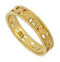 A richly engraved floral cutwork adorns the face of this 18K yellow gold Edwardian wedding band