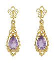 Fashioned of 14K yellow gold, these spectacular antique style earrings feature teardrop shaped amethyst framed with a delicate organic cutwork