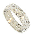 This radiant 14K white gold vintage wedding band is covered with perky five petaled blooms and curling leaves