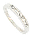 Ten radiant square cut diamonds glow from the face of this 14K white gold wedding band