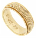 Seven lines of golden milgrain decorate this 18K yellow gold estate wedding band