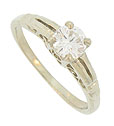 This elegant 14K white gold engagement ring is set with a dazzling .46 carat, H color, Si2 clarity round cut diamond