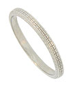 This distinctive antique platinum wedding band is adorned with an engraved ribbon of rectangular beads