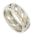 A string of curling leaves engraved with abstract floral figures decorates this unique vintage wedding band