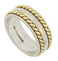 This 14K bi-color wedding band features a wide white gold band with a pair of deeply impressed channels set with bold twisting ropes of yellow gold