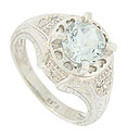 This captivating antique style platinum engagement ring is set with a dazzling ice blue 1.65 carat round cut aquamarine