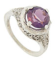 A stunning 2.49 carat, lilac hued amethyst is set into the face of this 14K white gold engagement ring