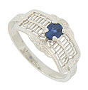 This unique 14K white gold cigar-band style engagement ring features an open web filigree frosted with organic engraving