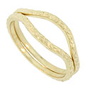 These curved 14K yellow gold antique style wedding bands are covered with floral designs in subtle relief