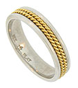 A pair of twisting 18K yellow gold ropes press into the center of this platinum estate wedding band