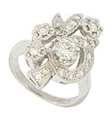 This spectacular floral inspired engagement ring features figural mountings shaped as leaves and full figured blooms