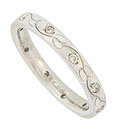 This 14K white gold antique style wedding band is embellished with a simple floral engraving