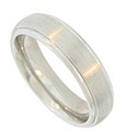 A Florentine finished center strip is flanked by polished edges on this 14K white gold men's wedding band