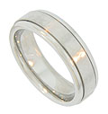 Two milgrain furrows decorate this 14K white gold antique style men's wedding band