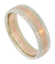 The center of this 14K gold antique style men's wedding band features a red gold band finished with a florentine surface