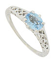 This delicate 14K white gold antique style engagement ring features a .55 carat, oval cut aquamarine