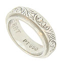 This lovely vintage platinum wedding band is engraved with a whimsical pattern of organic leaves and pansy blossoms