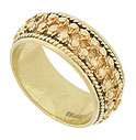 This unique 14K yellow gold estate wedding band is adorned with a repeating pattern of bold milgrain wrapped in twisting yarns of gold