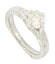A glittering .70 carat, H color, Si2 clarity, cushion cut stone is set into the face of this antique style engagement ring