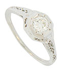 This 14K white gold antique style engagement ring is set with a .39 carat I color, Si1 clarity round diamond