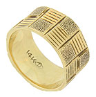 This unique 14K yellow gold wedding band features an alternating block pattern of horizontal engraving and hand hammered stippling