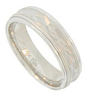 Sparkling jewel cut engraving adorns the center of this 14K white gold mens wedding band