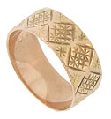 A whimsical repeating pattern of crosshatched engraving forms large diamond figures which appear to march across the surface of this 14K red gold wedding band