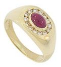 An oval cabuchon ruby is bezel set in the center of this 14k yellow gold estate mens ring