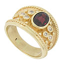 A spectacular 1.76 carat oval cut garnet is bezel set in the face of this 14K yellow gold estate ring