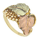 This phenomenal 10K tri-color estate ring features a realistic organic cutwork of yellow gold grapes and vines adorned with a pair of large leaves, one fashioned of green gold and one red gold