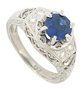 This captivating antique style platinum engagement ring is set with a 1.37 carat round cut sapphire