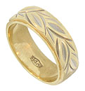 A riot of sparkling leaves dance across the surface of this 14K yellow gold estate ring