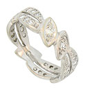 Sparkling marquis figurals and pairs of curling leaves twist across the surface of this antique platinum wedding band