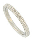 A delicate chain of diminutive daisies twirl around the face of this antique style platinum wedding band