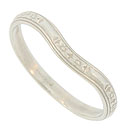 Pairs of impressed flowers press into the curling ribbon on the face of this 14K white gold curved wedding band
