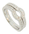 Repeating leaf and stem patterns adorn the face and sides of these 14K white gold stackable wedding bands