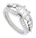 A fiery Carre cut diamond is set above the surface of this 14K white gold diamond engagement ring