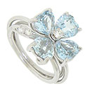 A sparkling quartet of heart shaped aquamarines spin around the face of this 14K white gold estate ring