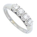 This glorious estate wedding band is crafted of 18K white gold and set with four fine faceted round cut diamonds