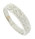 Crafted of 14K white gold, this antique style wedding band is decorated with a tumble of romantic blossoms and leaves